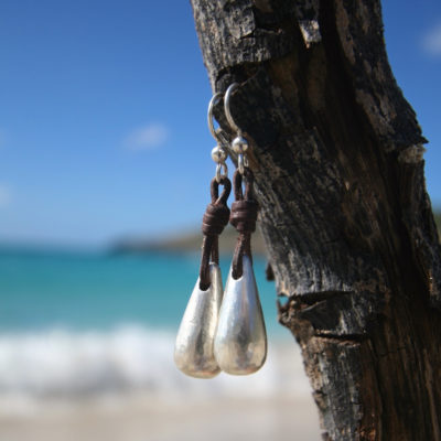 Handmade silver drops earnings strung on leather, boho jewelry, beach jewelry, leather jewelry, St Barth signature, textured drop eating.