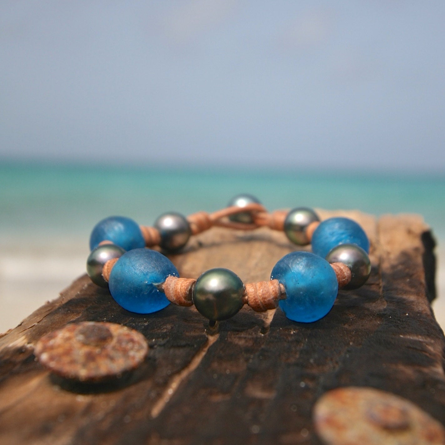 Leather and black pearls bracelet for women featuring African beads, beach summer jewelry, St Barts fashion, seaside coastal bohemian style