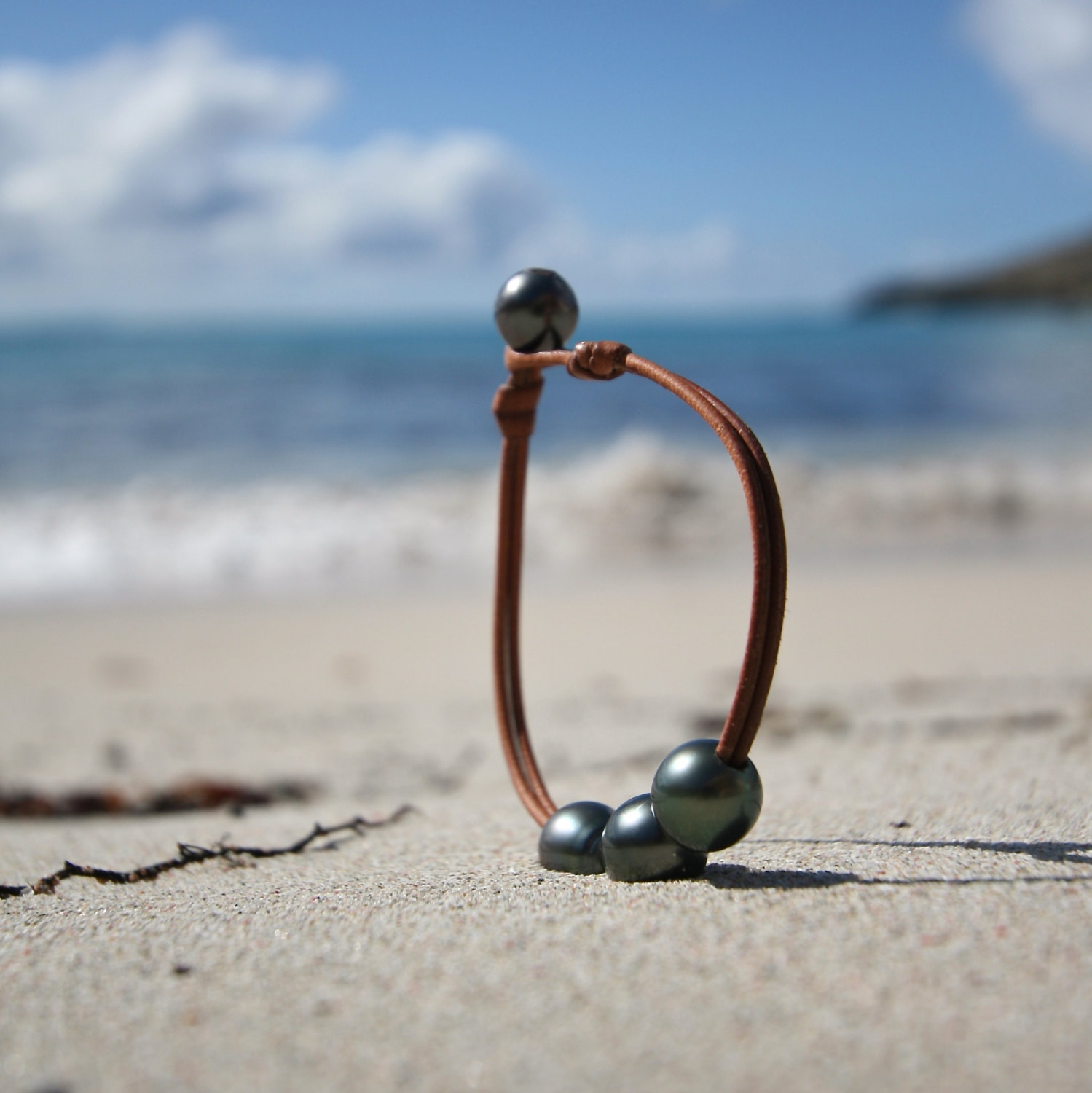 Trio of shinny Black cultured Tahitian pearls, minimalist jewelry on leather, St Barth island, boho and beach jewelery, bohemian style